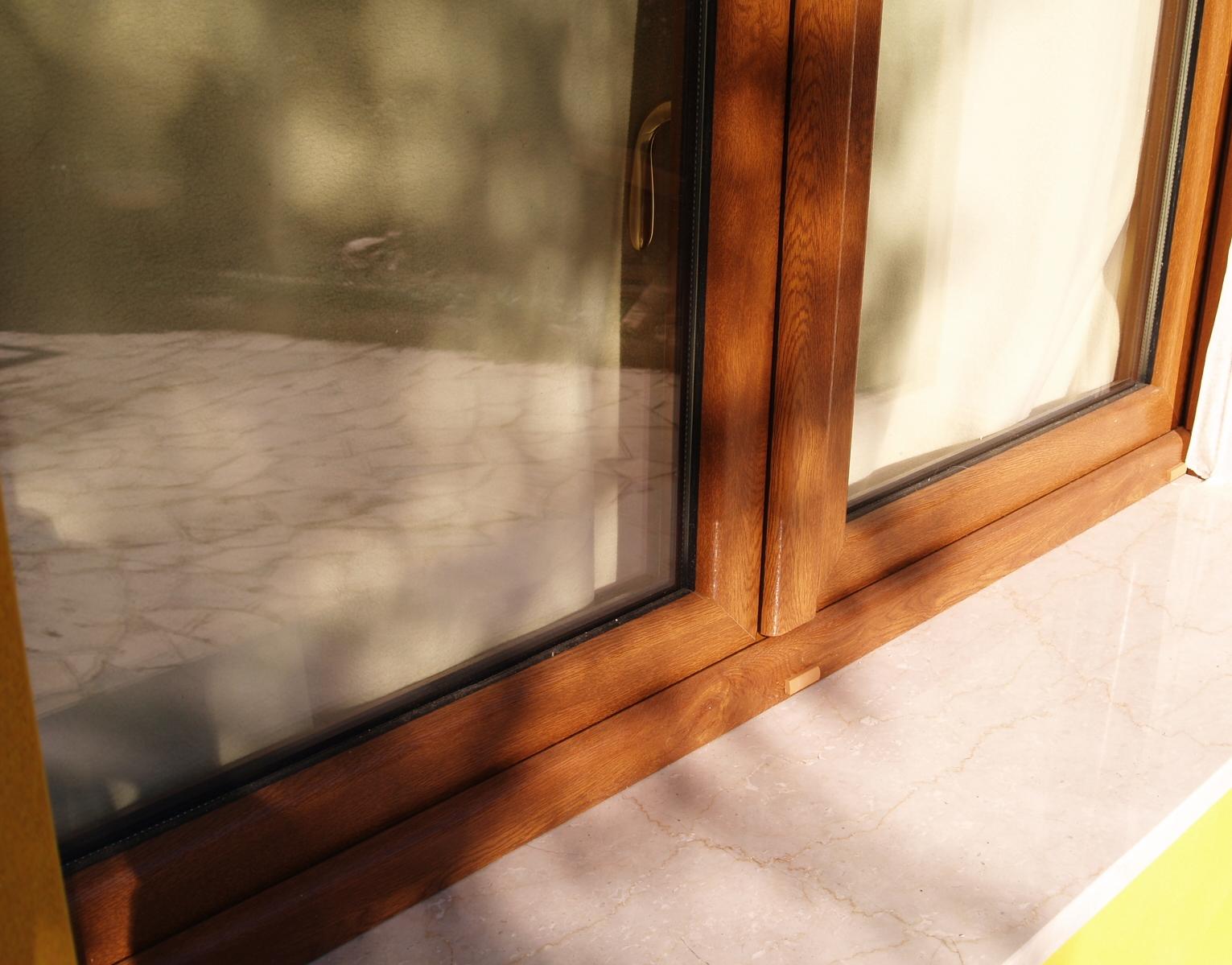 V8 trading serramenti in pvc rivestito effetto legno for Serramenti pvc legno
